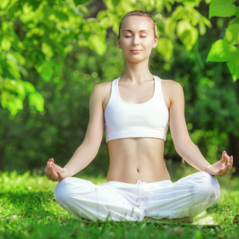 Yoga outdoors. Woman meditating in lotus position. Concept of he