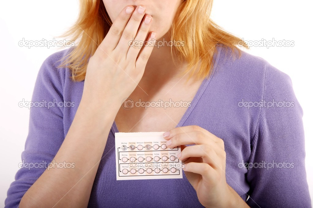 Woman with anti baby pill (white background)